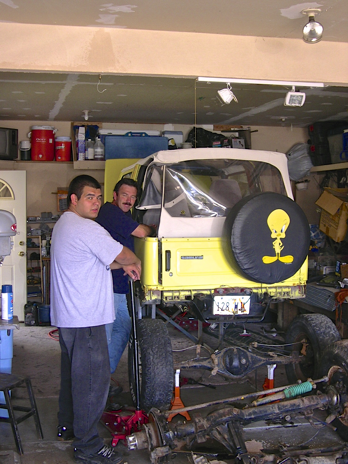 "Sean Conk with his father Steve working on ""Tweety"" in their home garage."
