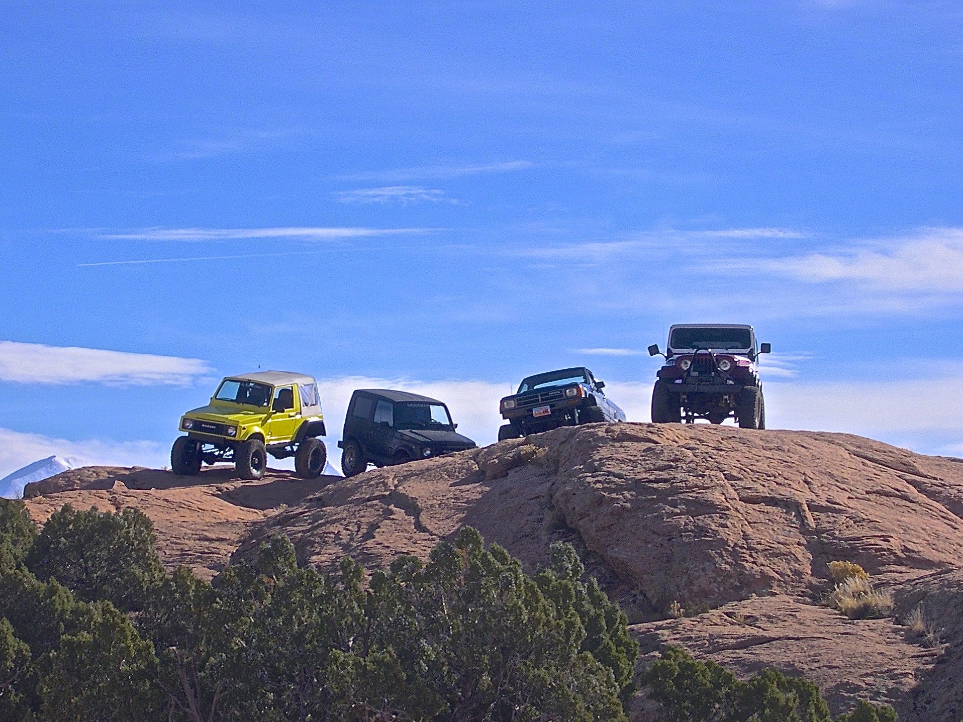 Rigs belonging to: Steve, Sean, and Chris Conk and friend Don on trail in Moab, Utah, USA
